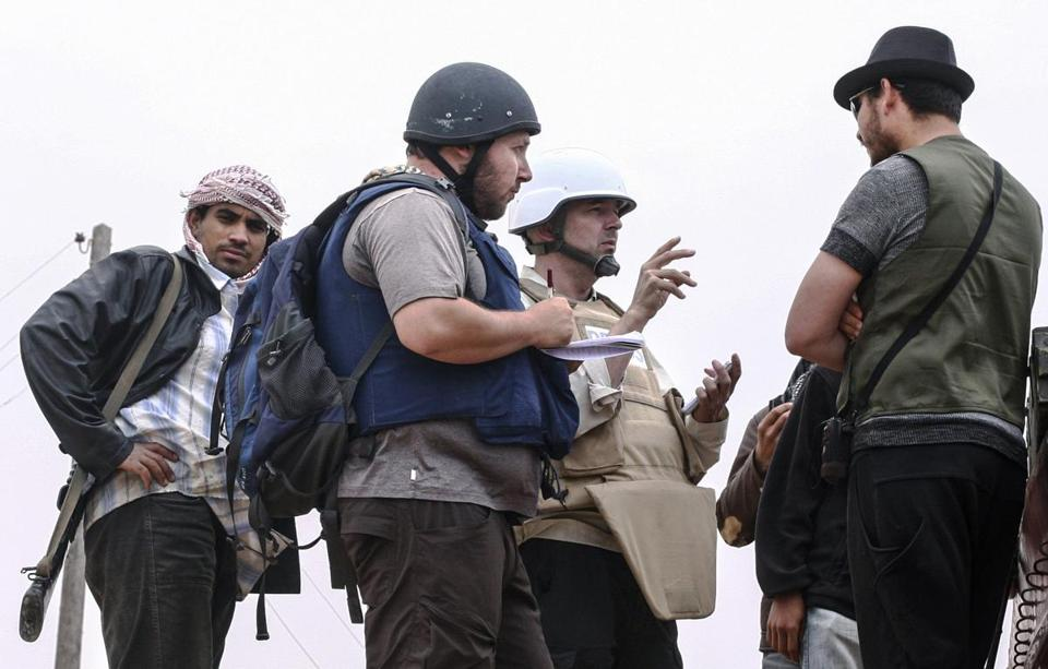 American journalist Steven Sotloff (second from left) is pictured in Libya.